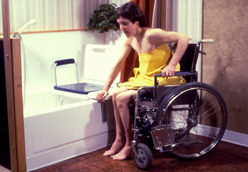 This was one of five images (PHIL# 9170 - 9174), depicting the action of two different mobility-challenged women getting into a bathtub by m