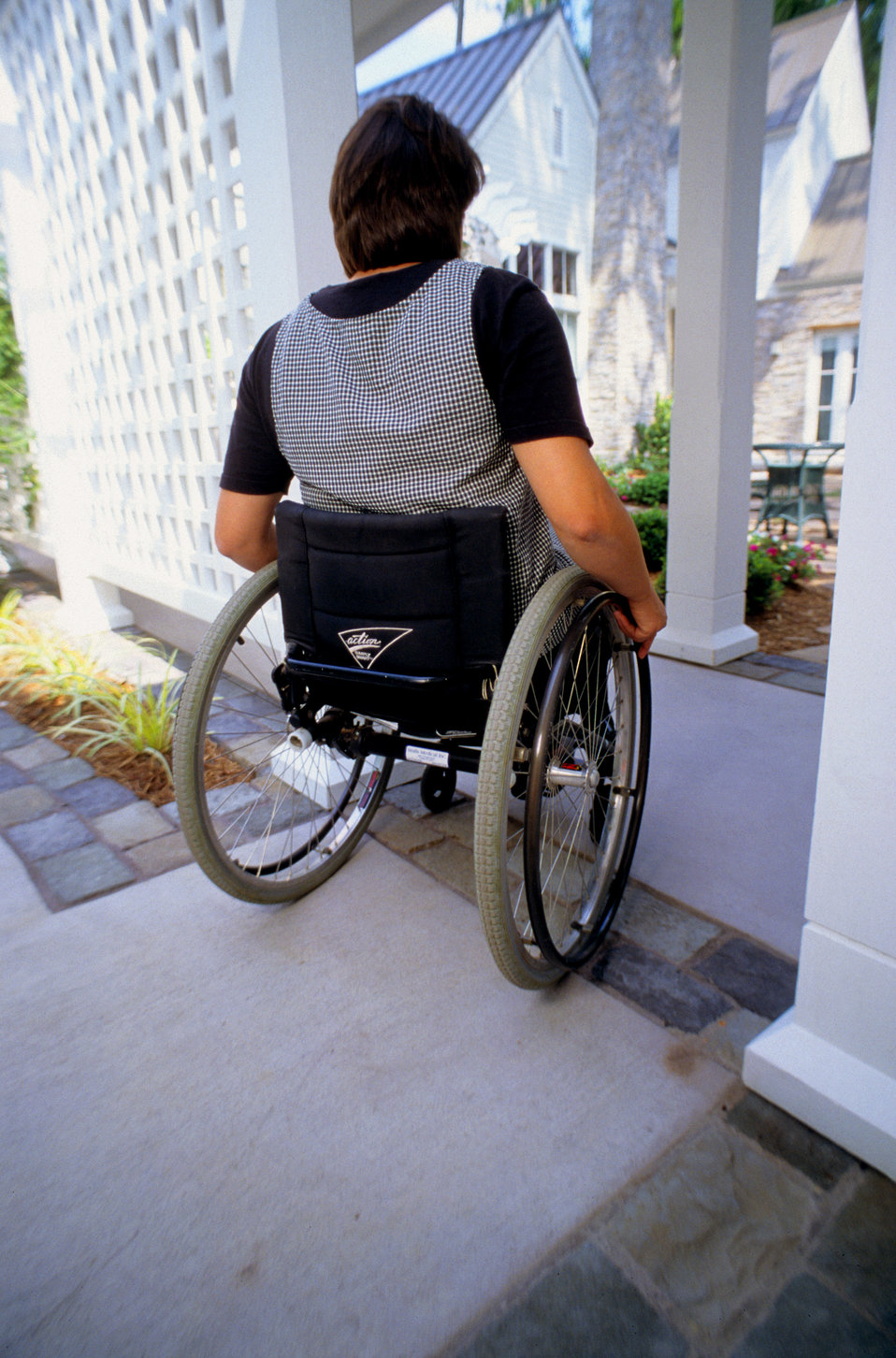 This is one of two images, (PHIL# 9165, 9166), which depicted an adult mobility-challenged woman, who was in her wheelchair as she was rolli