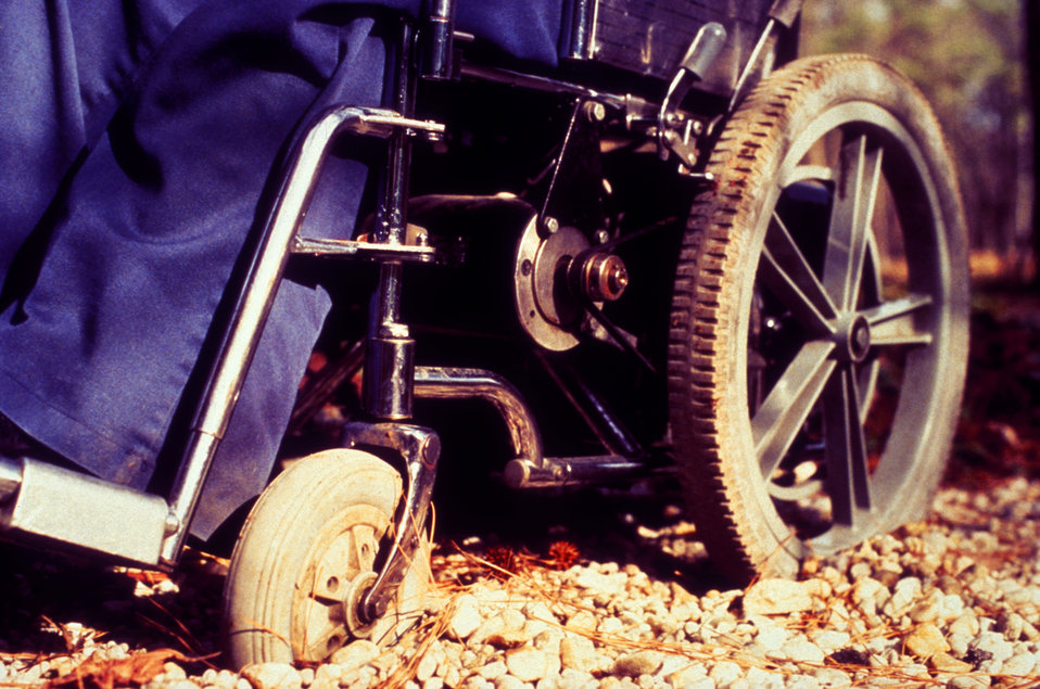 This 1994 image depicted a scenario common to wheelchair users, involving the difficulties in maneuverability of the chair's wheels encounte