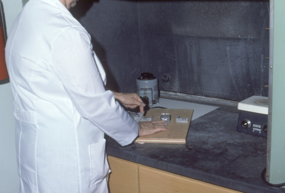 This laboratorian is demonstrating the removal of a Falcon� Flask top with a 'hot' wire during an amniotic fluid test.