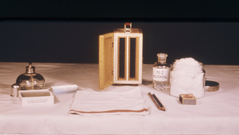 This photograph depicts the lab supplies used in making thick and thin blood films.