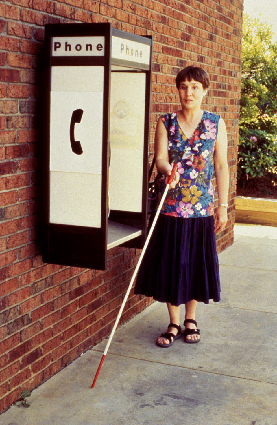 This visually-impaired woman was using a walking stick in order to 'extend her reach' in order to detect obstacles in her path. Using a 'swe