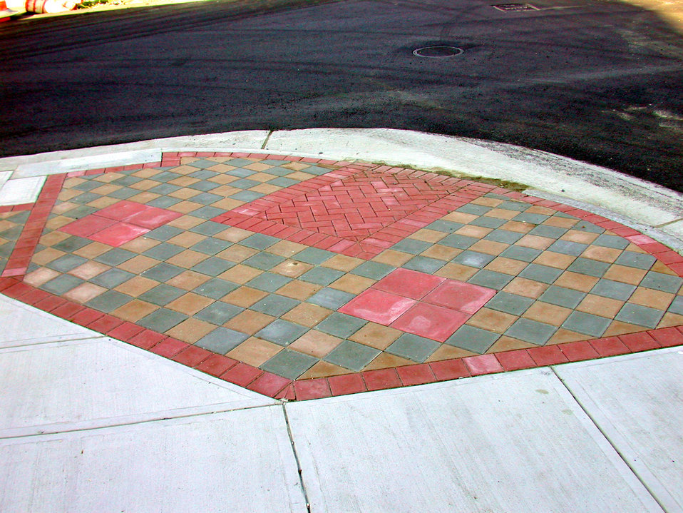 This 2005 image depicted the installation of a colorful, textured 'curb ramp', which provided a transition point between the roadway at a lo