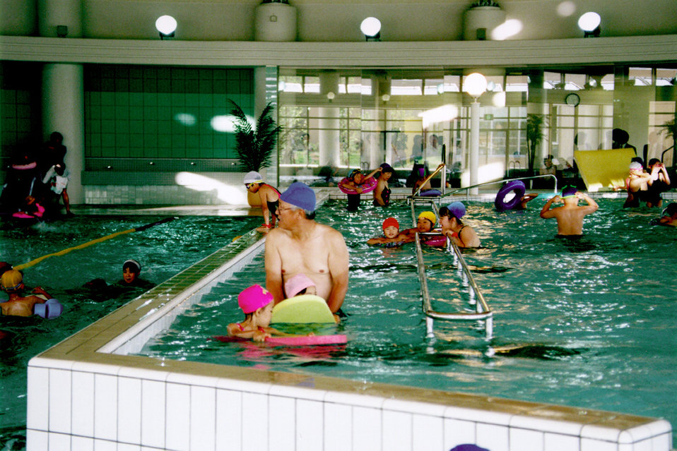 This is one of a series of three photographs (PHIL# 9096 - 9098), which revealed the interior of a large indoor publicly-accessible swimming