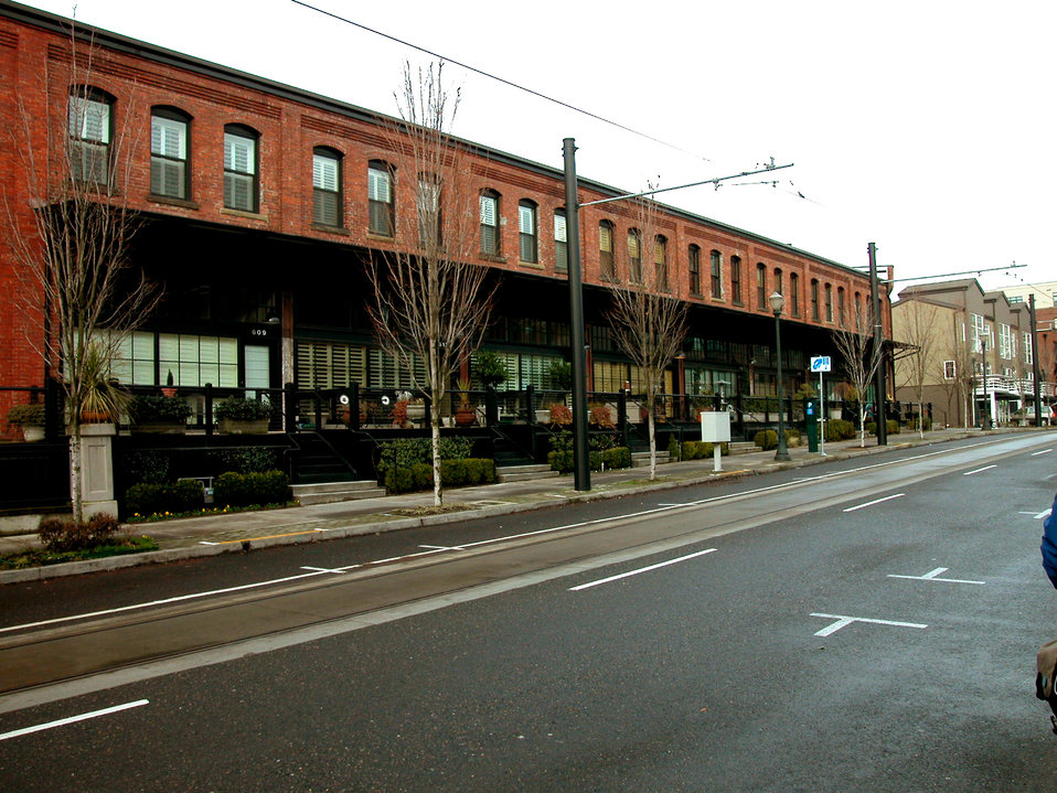 The partially raised sidewalk in this 2004 image, revealed how this configuration allowed for a grade separation, while providing the opport