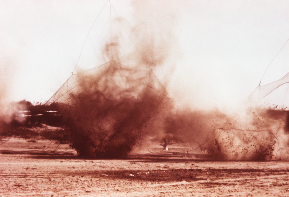 This photograph shows the firing of cannon nets during the attempted capture of birds during an arbovirus field study.