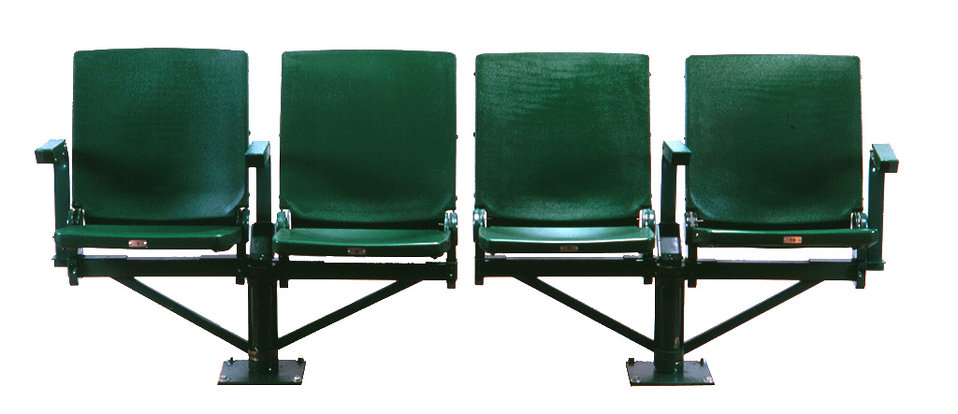 This was one of five images (PHIL# 9139 - 9143), depicting four rotating, folding stadium seats in the 'open' position, which provided a uni