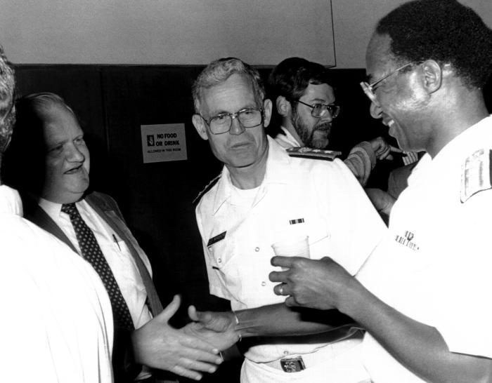 This photograph shows Jim Hicks, Dr. James O. Mason, and Dr. Donald R. Hopkins during a CDC event.