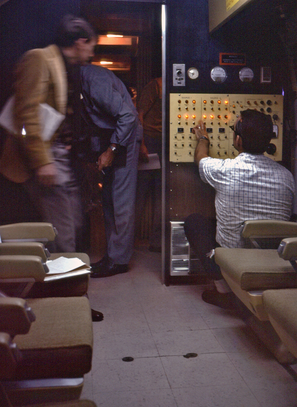 This 1976 photograph revealing the interior of CDC's mobile quarantine facility (MQF), showed an individual who was seated at right at the o