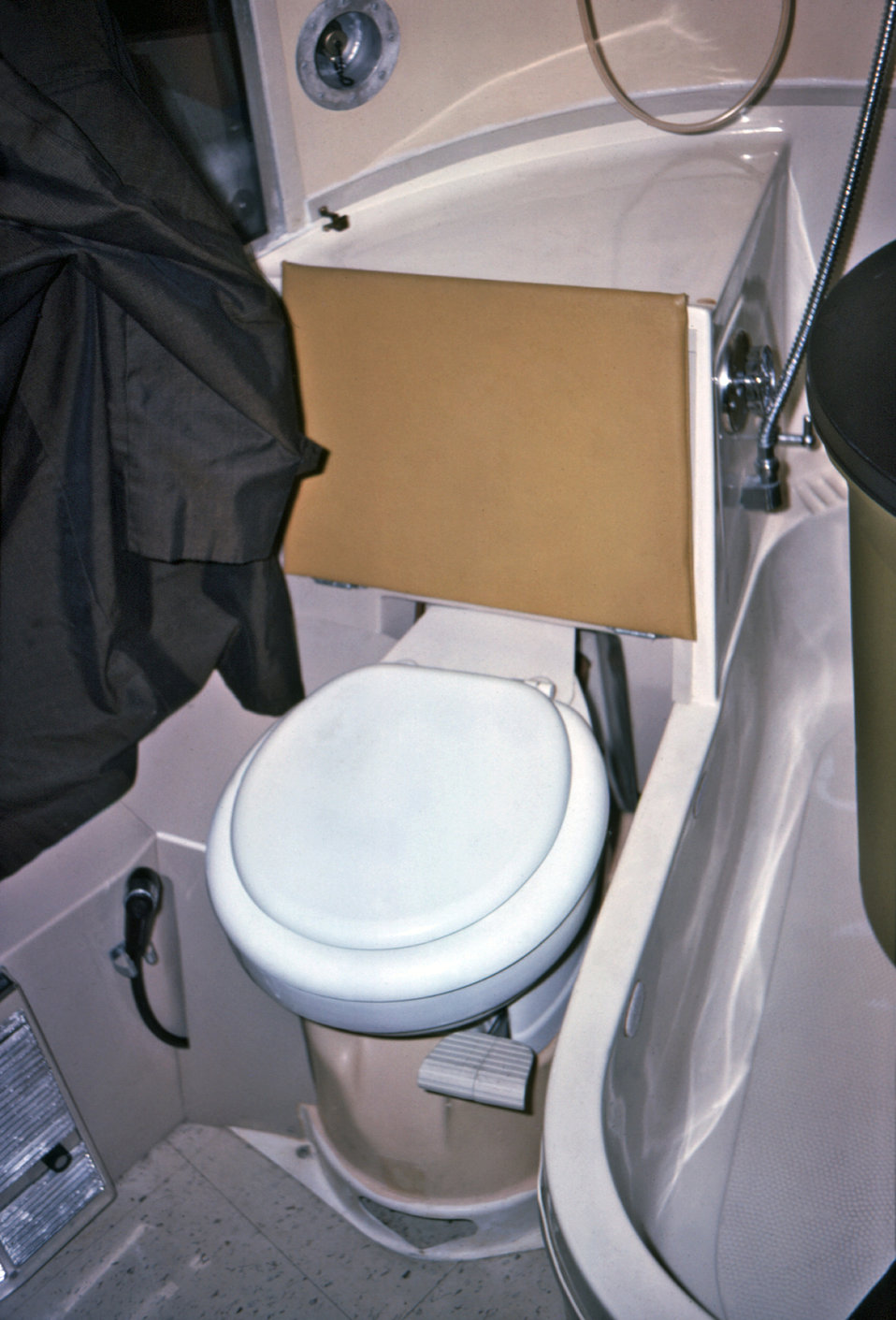 Shown here was the bathroom toilet and tub located within a mobile quarantine facility (MQF), which was photographed during a 1976 simulated