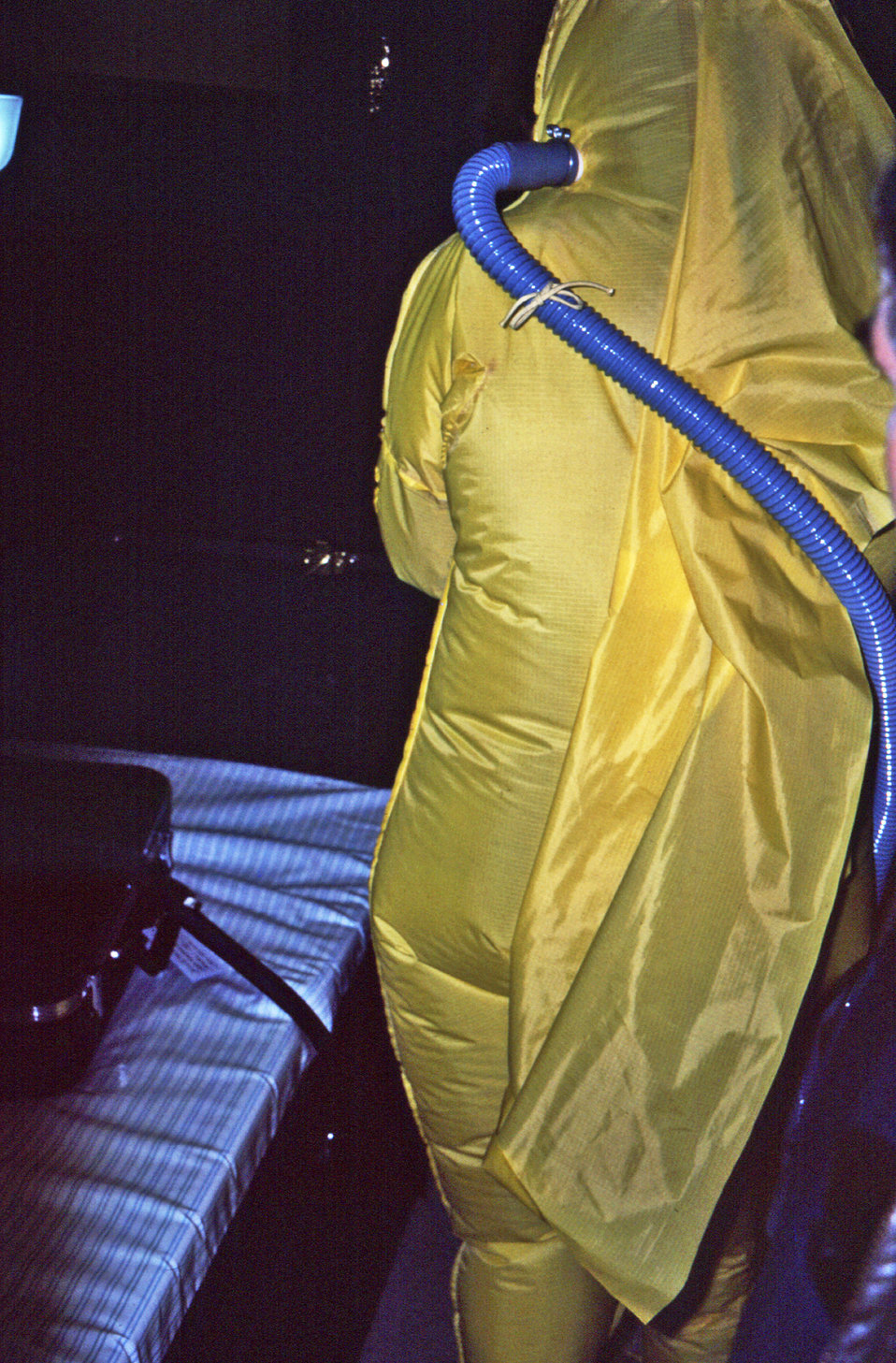 This 1976 photograph was taken during a medical quarantine simulation in a mobile quarantine facility (MQF), and depicted the back of an ind