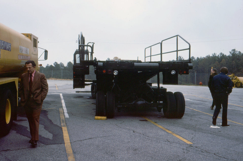 This 1976 photograph showed the loading device, which was used to move the mobile quarantine facility (MQF), on and off of its transport air