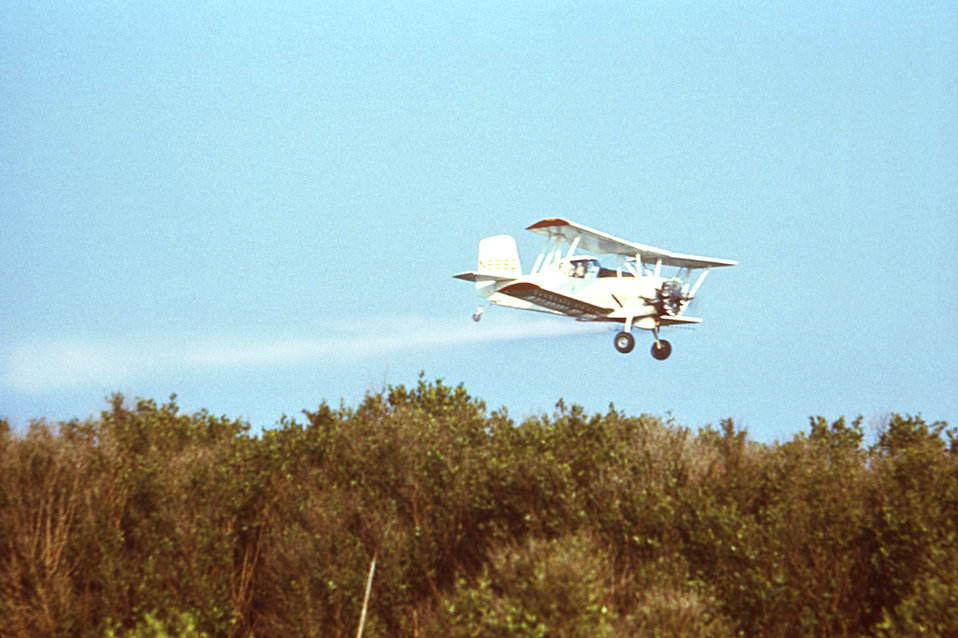 This photograph depicts a Grumman AgCat aircraft that had been outfitted with an insecticidal spray mechanism, enabling it to deposit insect