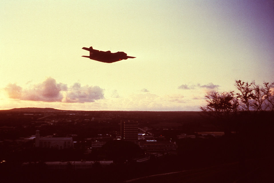 This 1975 photograph depicts a C-123 USAF aircraft dispersing an insecticidal spray over Guam in order to control a Dengue fever outbreak.
