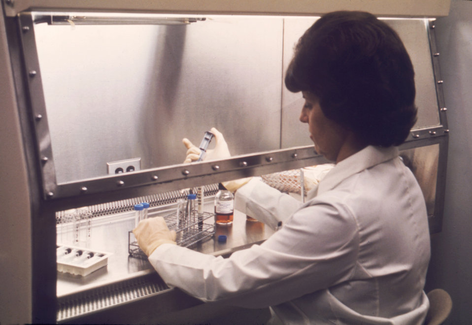 This CDC laboratory technician is performing analyses on amniotic fluids.
