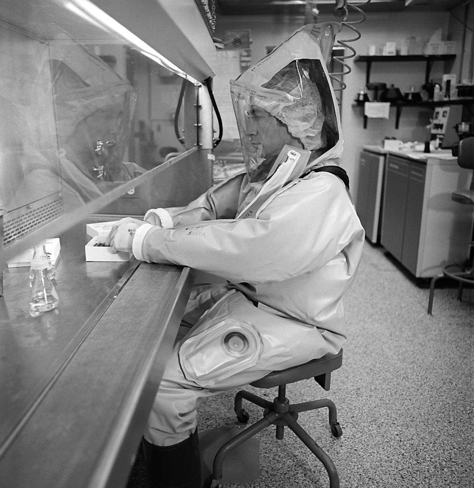Here a CDC scientist conducts laboratory research in the Biosafety Level 4 laboratory, Atlanta, GA.