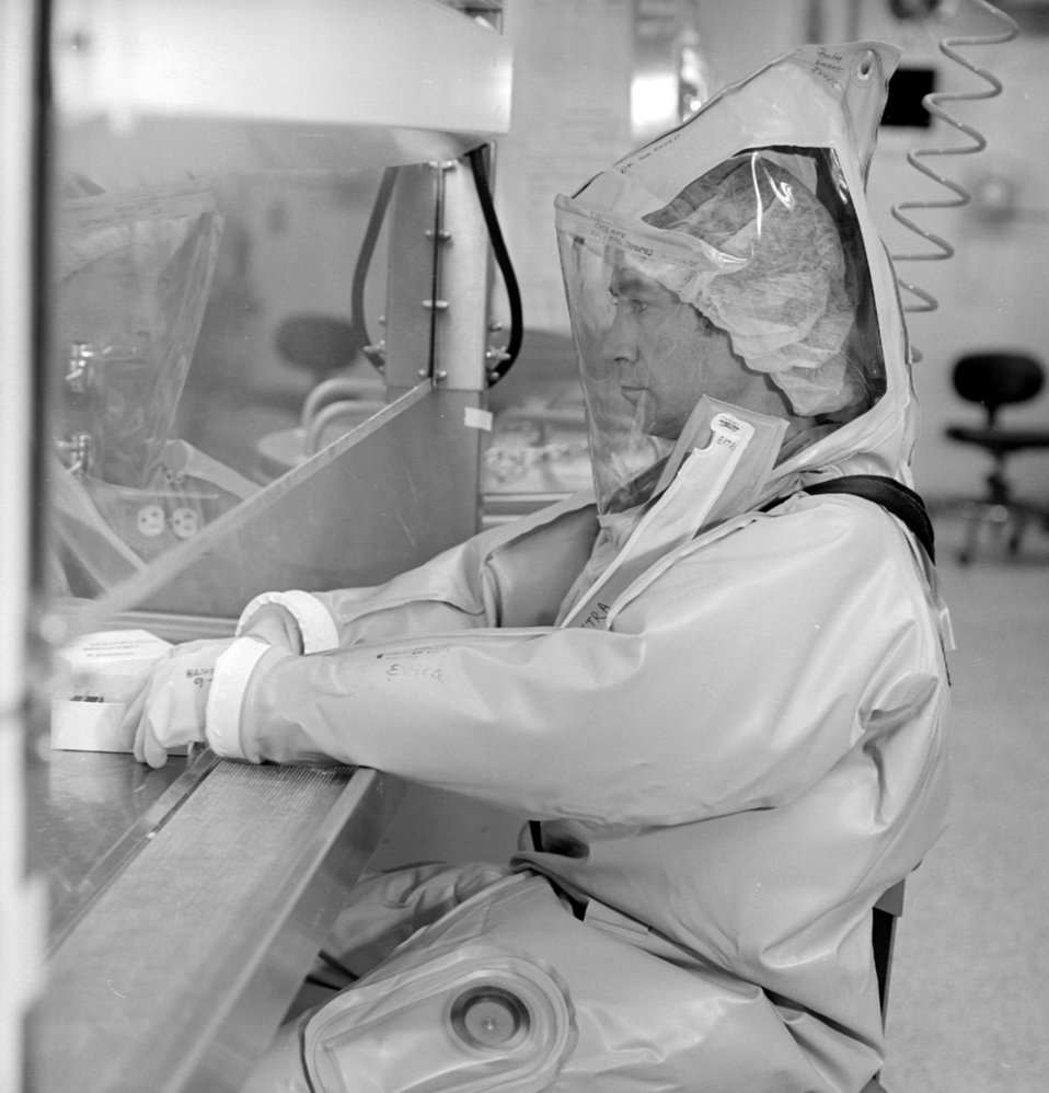 A CDC scientist conducts laboratory research in the Biosafety Level 4 laboratory.