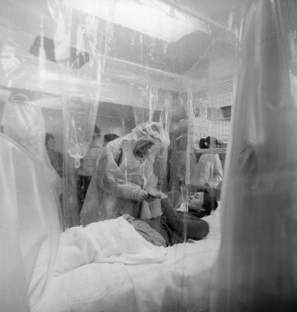 A photograph of a patient in a Vickers Isolation Unit.