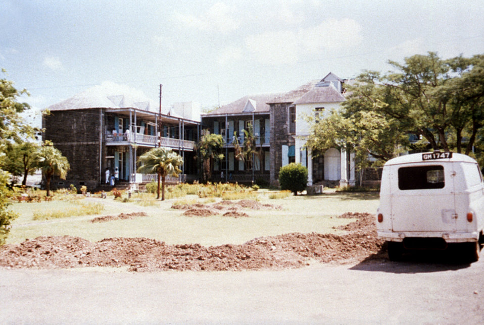 This 1980 photograph depicts the men's ward and surgical building of the Port Louis, Mauritius Civil Hospital.