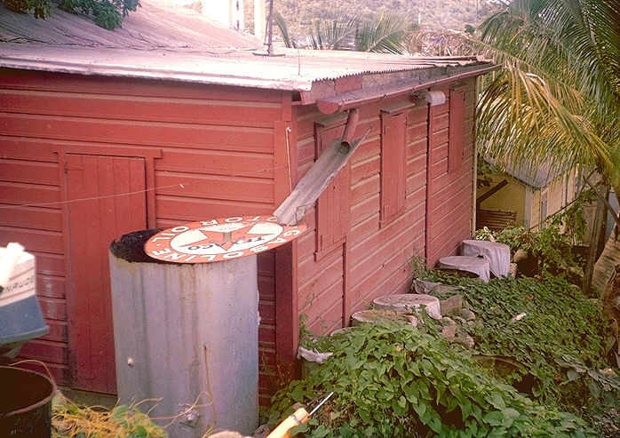 Large water receptacle not adequately covered to prevent mosquito breeding, St. Thomas, Virgin Islands.