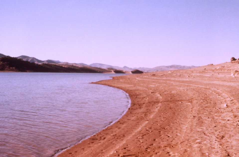 This 1976 photograph shows the red sandstone shoreline of Horsetooth Reservoir in Colorado.