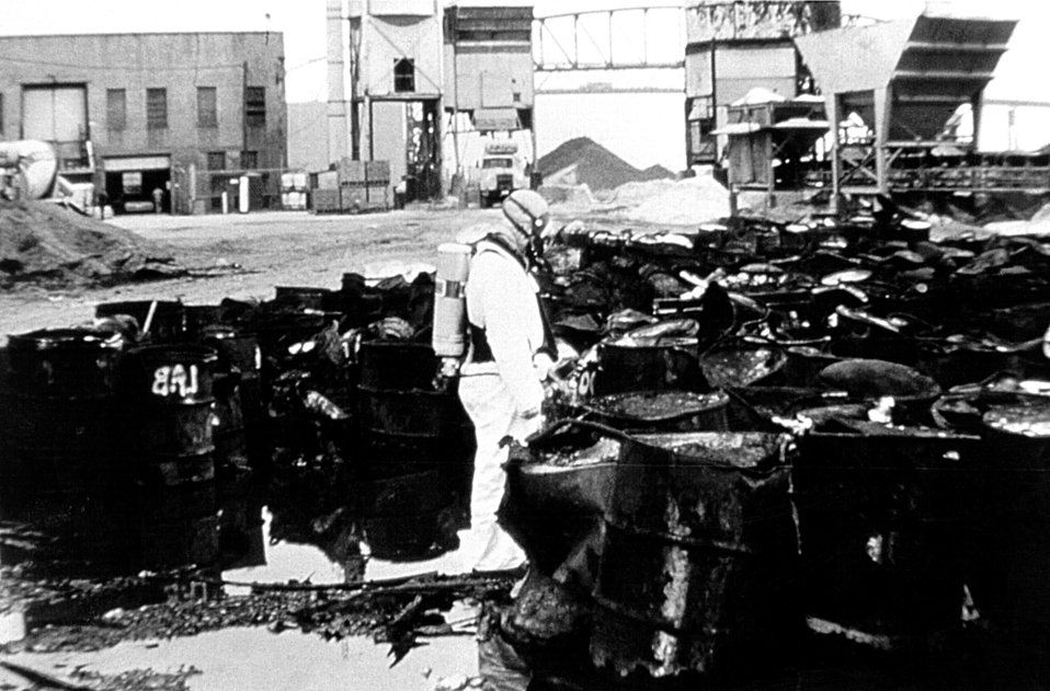 This was a hazmat technician analyzing the contents of a toxic waste dump while wearing a protective suit.