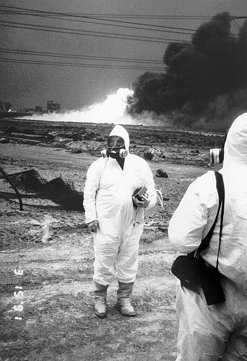 This was a hazmat technician analyzing the contents of a potentially environmentally toxic site wearing a protective suit.