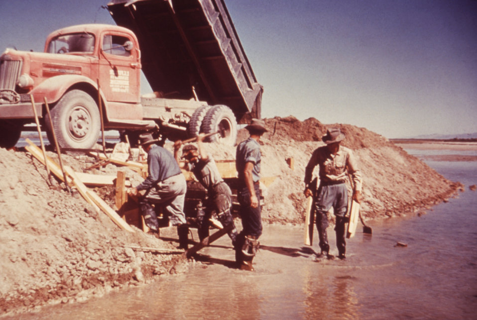 These men were constructing a dike and weir as part of the Wheeler Project in Utah during the mid 1970's.
