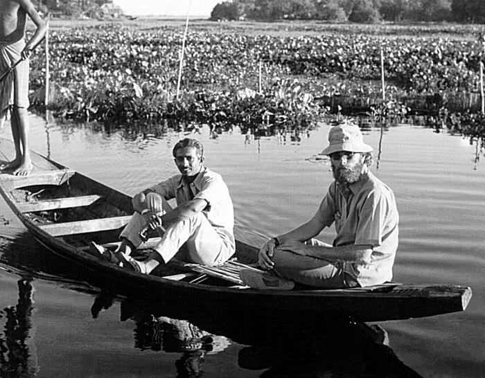 Here Jeff Koplan, M.D., M.P.H., and his counterpart are involved in smallpox-related field care in Bangladesh during the 1970's.