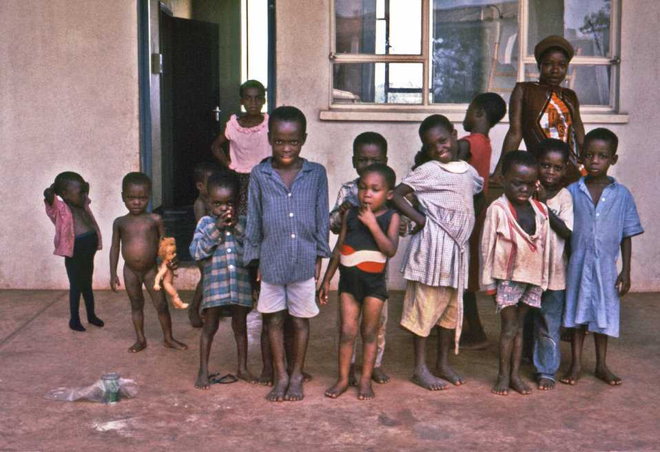 These children were standing outside a school in the southeastern area of Nigeria during the Biafran war of the late 1960s.
