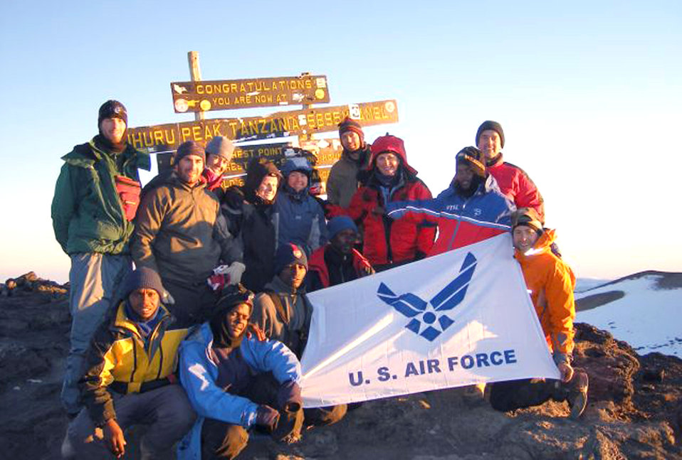 Team conquers mountain summit on quest