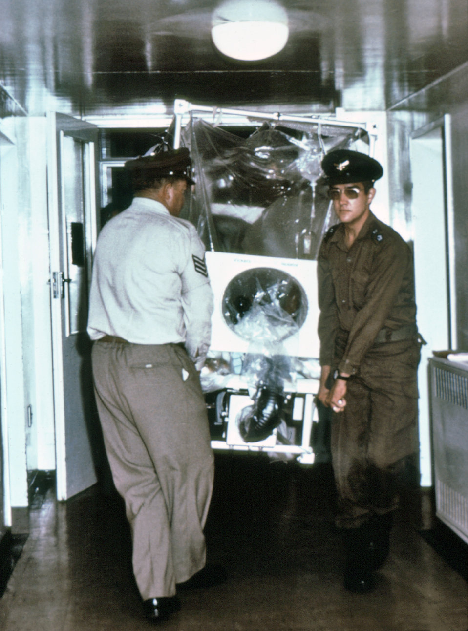 This 1976 photograph, taken inside the Johannesburg Fever Hospital, showed these South African Air Force personnel carrying an isolator unit