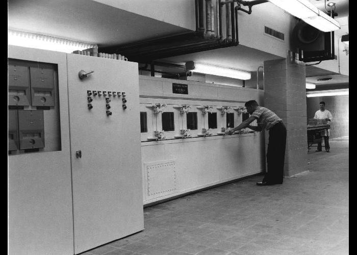 Mechanized laboratory glassware washer (Woodman machine).