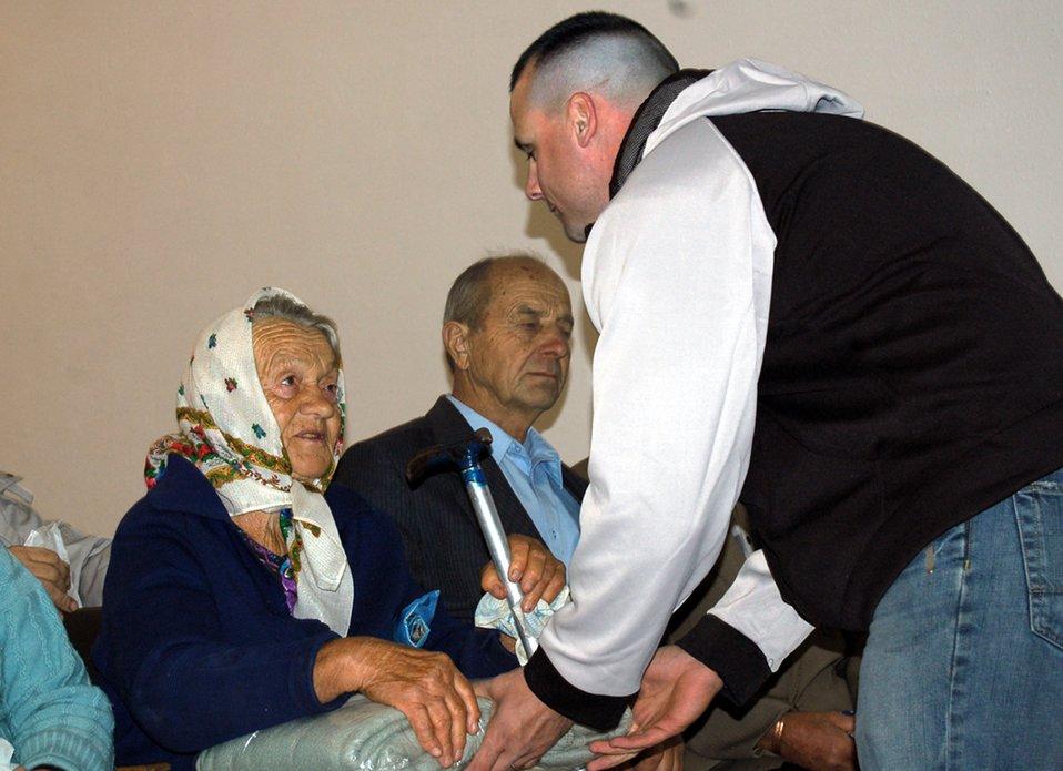 Manas Airmen honor village elderly