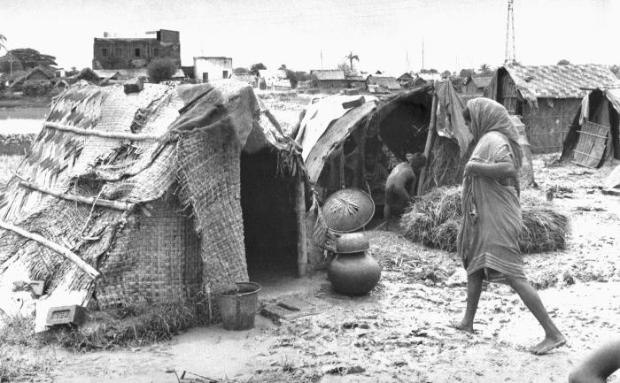 These were temporary 'homes' that had been constructed alongside a river inside a Bangladesh rural community. Groupings of makeshift tent dw
