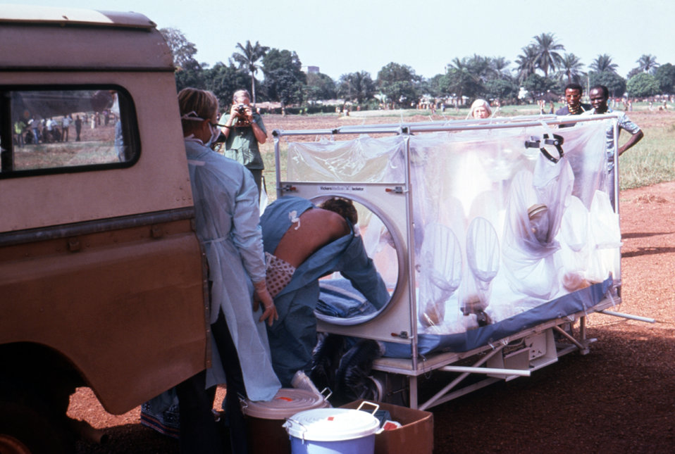 Shown here during a 1976 medical evacuation in Zaire, suspected Ebola patient Del Conn is shown being transferred from a vehicle into a plas