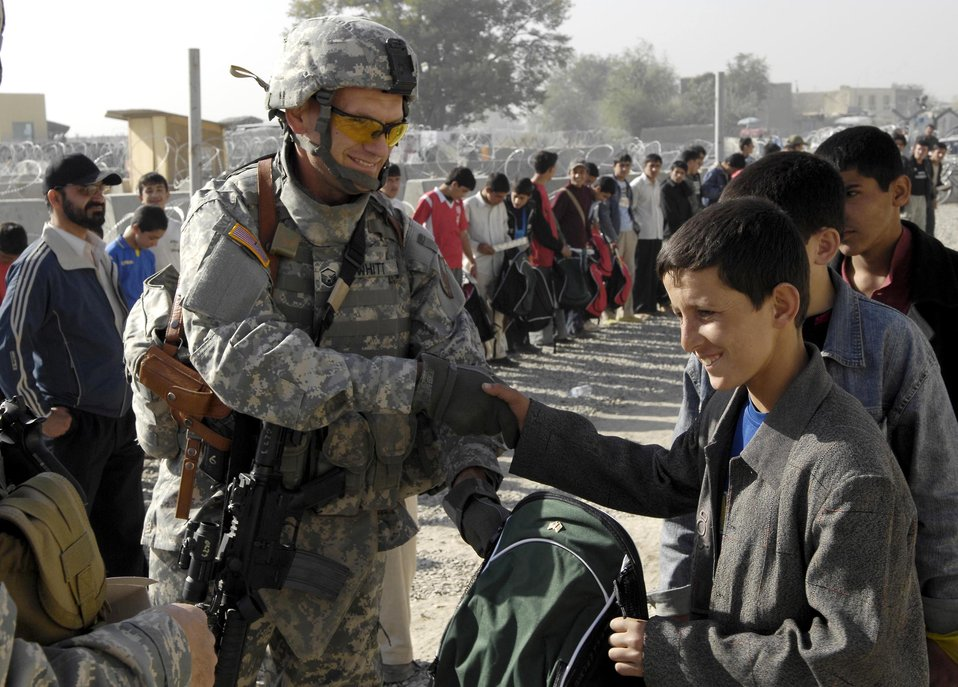 Kabul Airman brings gifts, smiles to local children