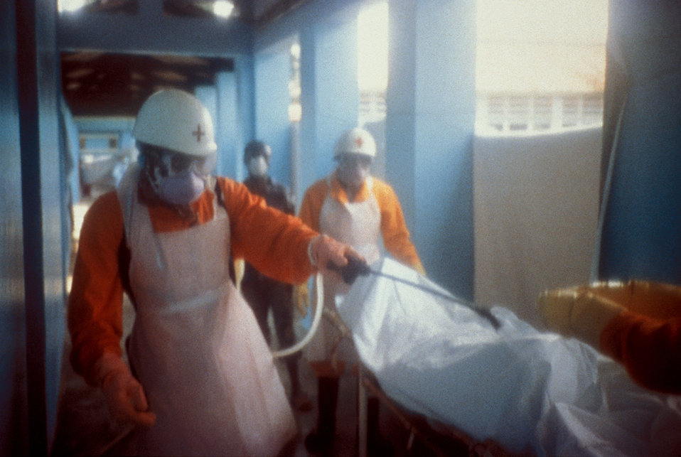 This local Red Cross team is disinfecting a body bag of an Ebola patient in Kikwit, Democratic Republic of the Congo, 1995.
