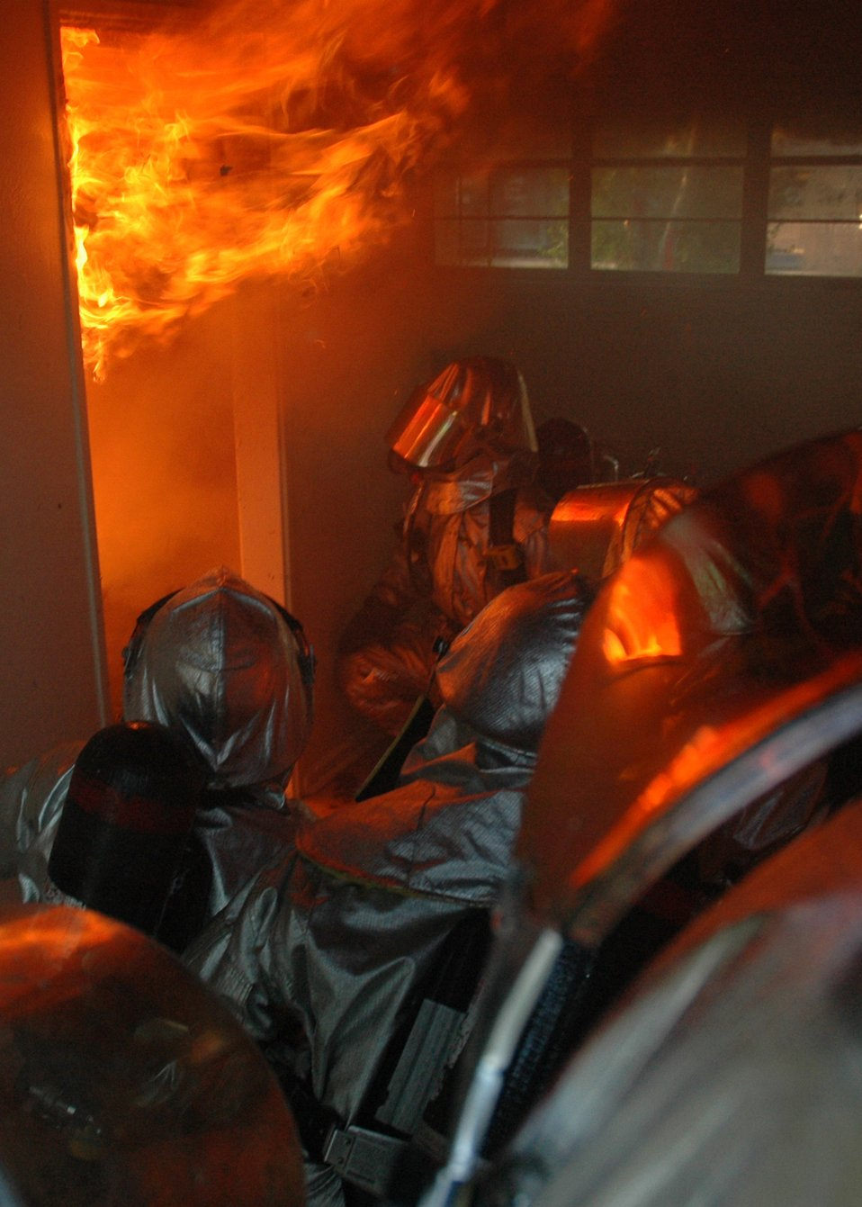 Air Force firefighters fuel flames for live fire training