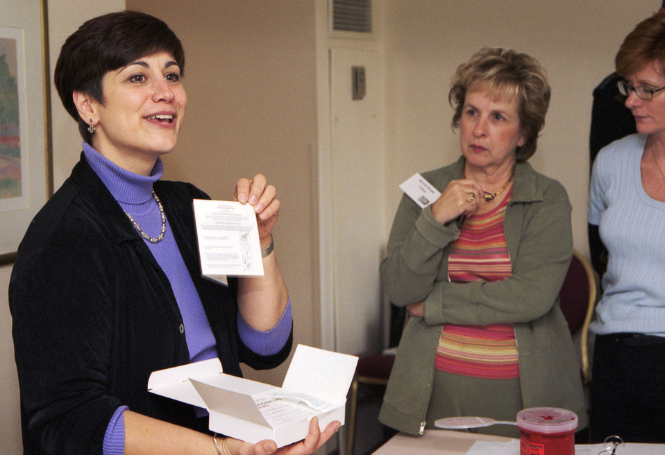 CDC Clinician, Joanne Cono, MD, describes contents of smallpox vaccine kit during the 2002 Vaccinator Workshop.
