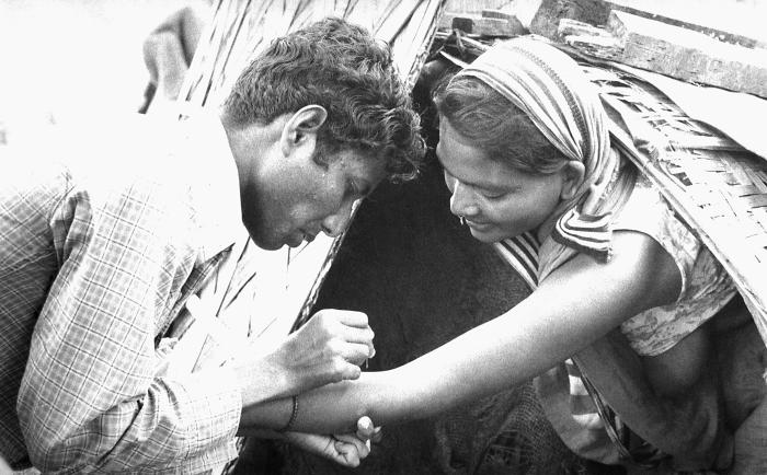 This volunteer smallpox eradication team vaccinator was in the process of administering a vaccine to a woman who at the time, was living wit
