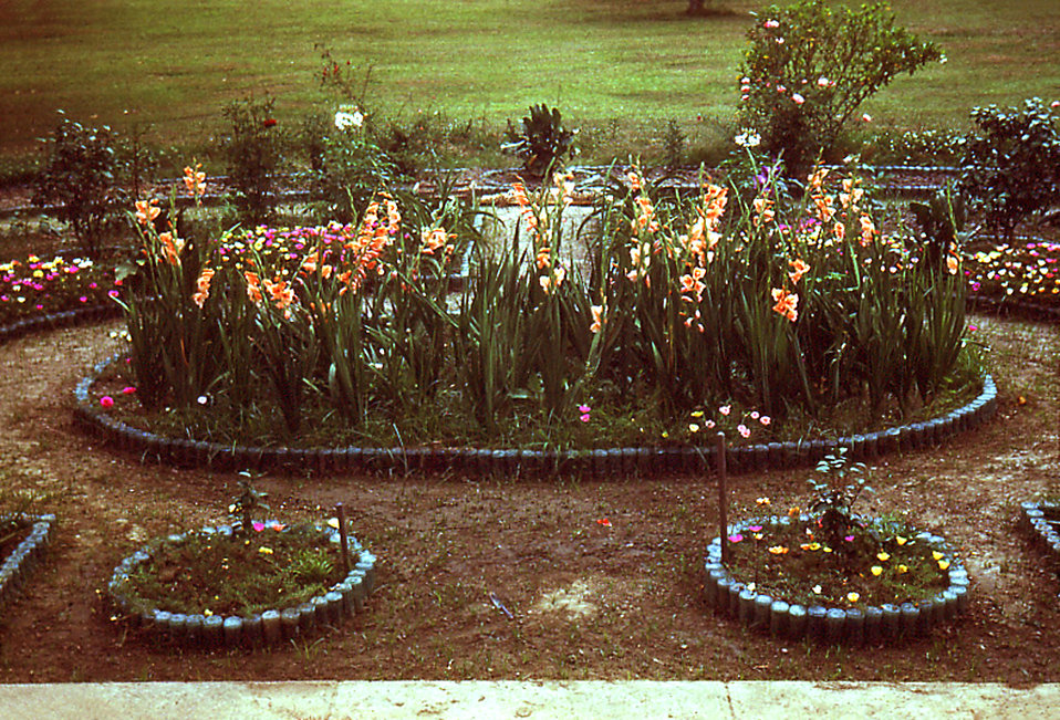 Grown by a Carville, Louisiana Leprosarium patient, this quaint garden was constructed from used Coca-Cola bottles that had been discarded b