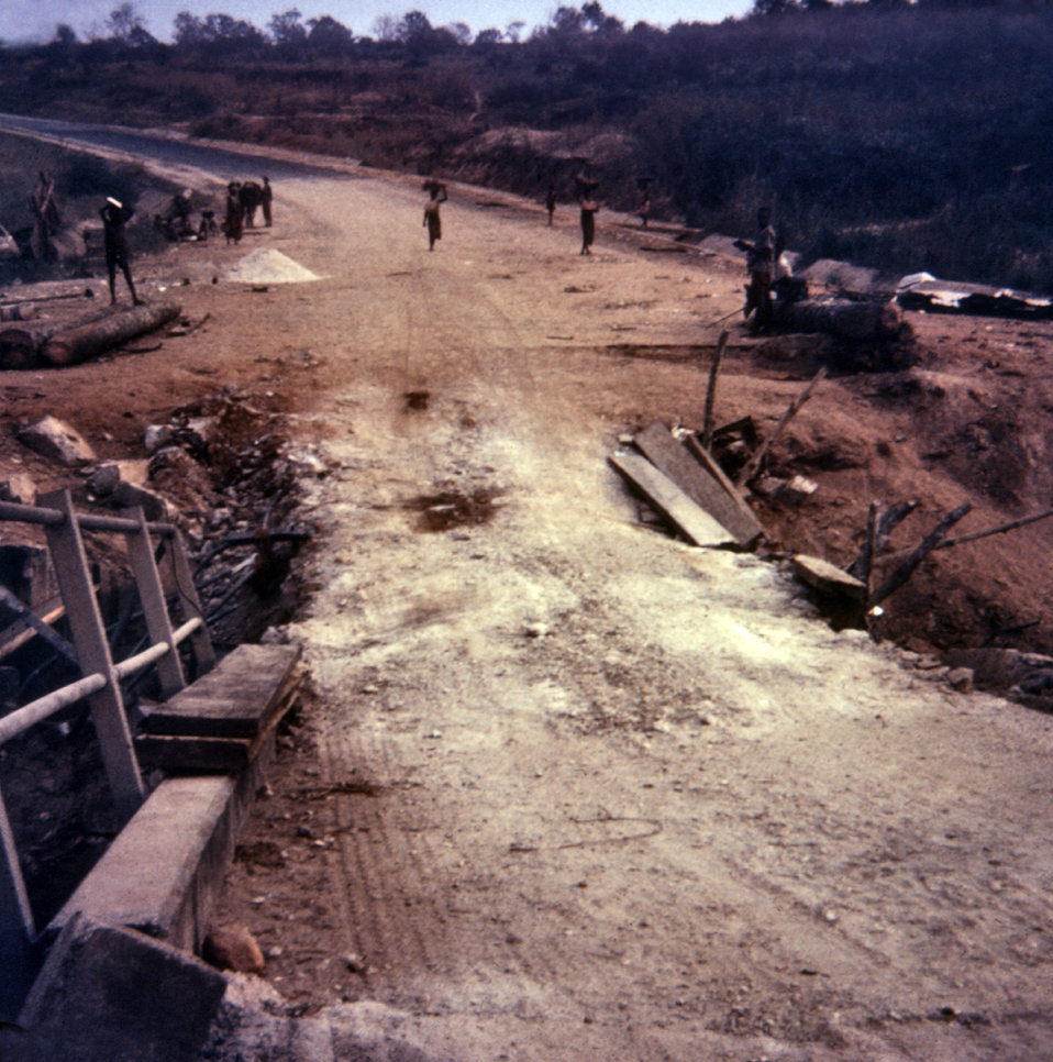 This photograph depicted the treacherous 'roads' in Nigeria after the Biafran war, in which buried land mines had damaged bridges that made