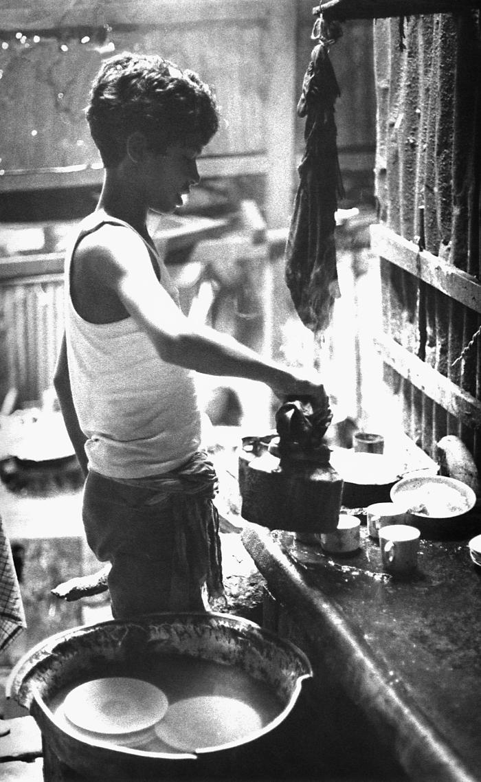 This image depicted a Bangladesh boy as he was pouring tea in a restaurant setting. This photograph provided by Dr. Stan Foster, and capture