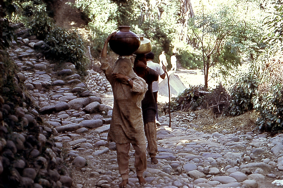 This 1974 photograph captured these Northern Indian women carrying water jugs by balancing them atop their heads.  The water is usually gath