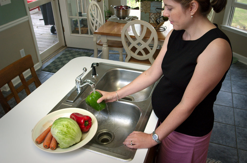 This photograph depicted a closer view of PHIL 7905 in which pregnant woman was in the process of washing a batch of assorted produce prior