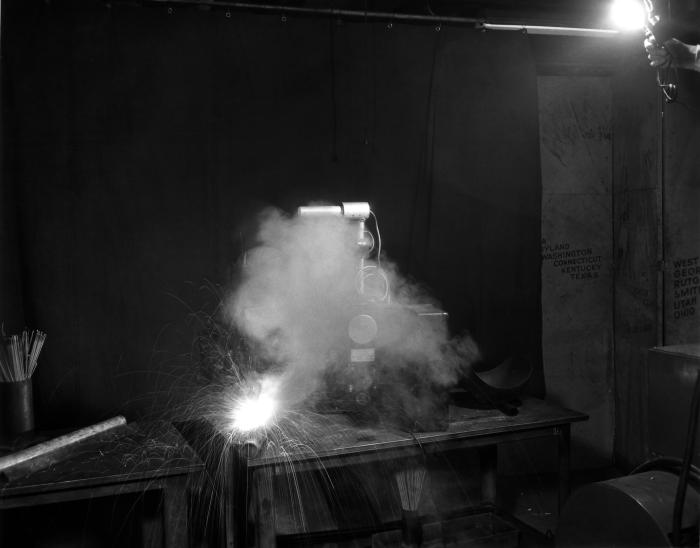 In this 1946 historical photograph an industrial hygiene air sampling flowmeter was shown in the process of sampling the air around a weldin