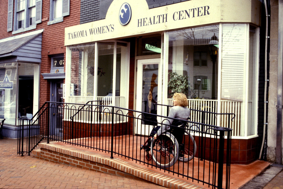 In this 1993 image, the front of a women's clinic revealed a front door that had been accessible via a two-step stoop, which made accessibil