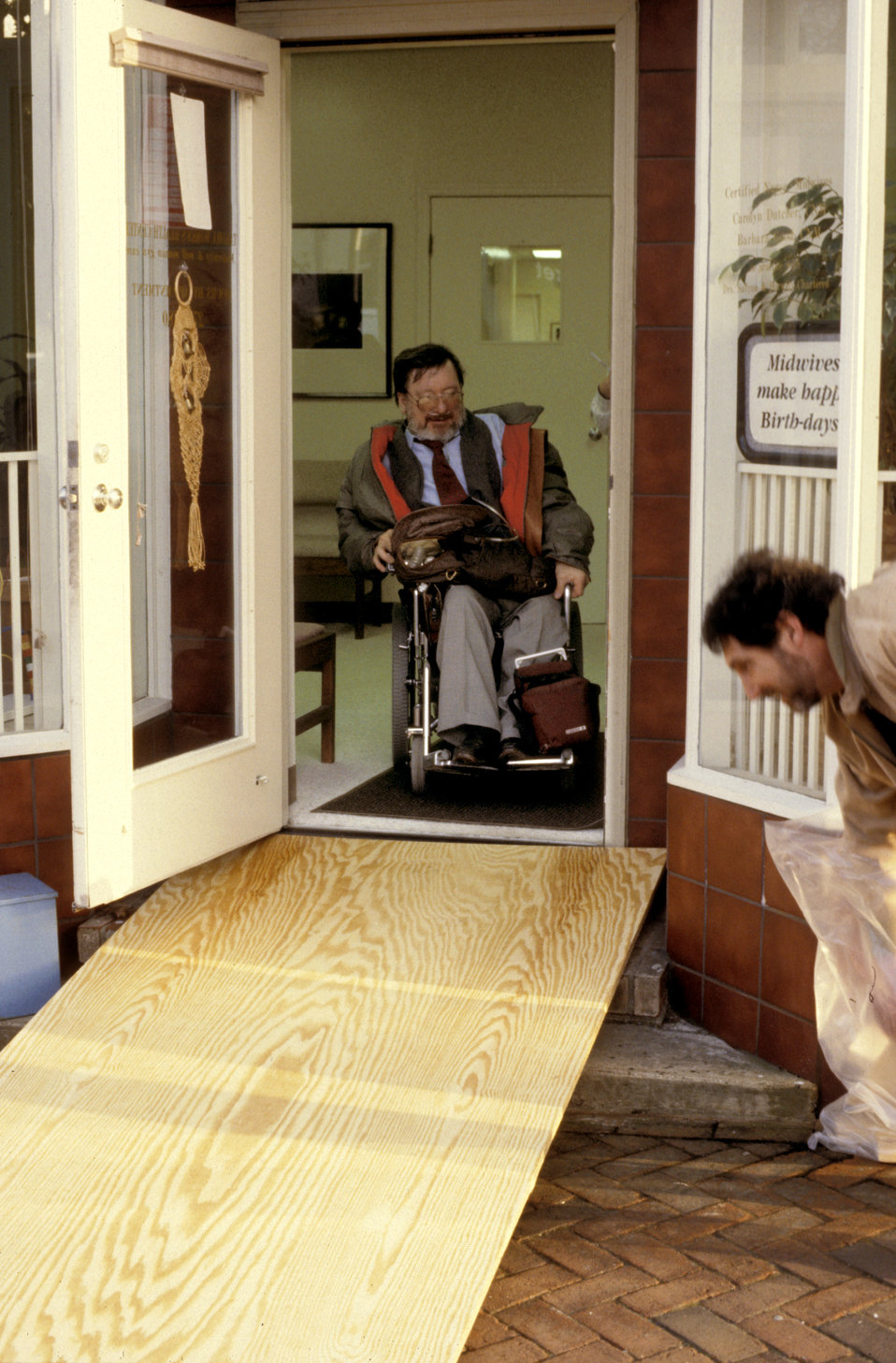 In this 1993 image, the front of a women's clinic revealed a front door that was accessed via a two-step stoop, which made accessibility an