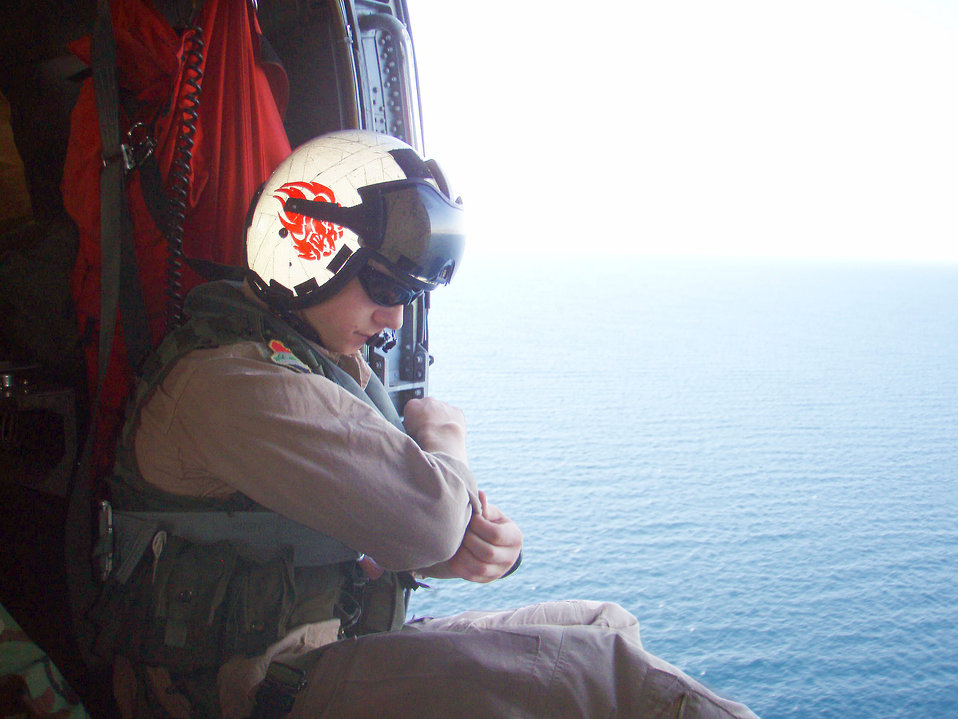 Photographed by U.S. Public Health Service (USPHS) Lt. Cmdr. Gary Brunette this image depicted a helicopter crewmember onboard the transport